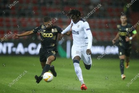 Rangers' Calvin Bassey, center, vies for the ball with Liege's Mehdi Carcela, left, during a Europa League Group D soccer match between Standard Liege and Rangers at the Maurice Dufrasne stadium in Liege, Belgium