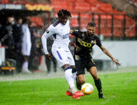 Rangers player Calvin Ughelunda (L) in action against Standard Liege player Mehdi Carcela-Gonzalez (R) during the UEFA Europa League group D soccer match between Standard Liege and Glasgow Rangers in Liege, Belgium, 22 October 2020.