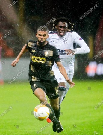 Rangers player Calvin Ughelunda (R) in action against Standard Liege player Mehdi Carcela-Gonzalez (L) during the UEFA Europa League group D soccer match between Standard Liege and Glasgow Rangers in Liege, Belgium, 22 October 2020.