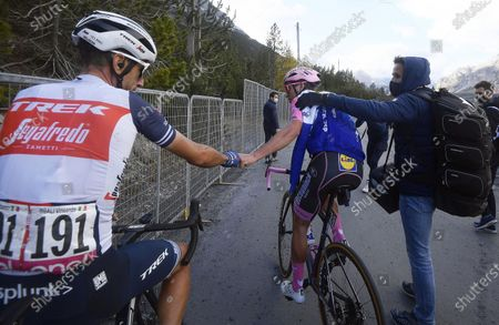 Stock Photo of Portuguese rider Joao Almeida (C) of the Deceuninck Quick-Step team and Italian rider Vincenzo Nibali (L) of the Trek Segafredo team react after the 18th stage of the 2020 Giro d'Italia cycling race over 207km from Pinzolo to Laghi Di Cancano, Italy, 22 October 2020. Almeida lost the overall leader's pink jersey.