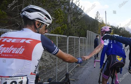 Stock Picture of Portuguese rider Joao Almeida (R) of the Deceuninck Quick-Step team and Italian rider Vincenzo Nibali (L) of the Trek Segafredo team react after the 18th stage of the 2020 Giro d'Italia cycling race over 207km from Pinzolo to Laghi Di Cancano, Italy, 22 October 2020. Almeida lost the overall leader's pink jersey.