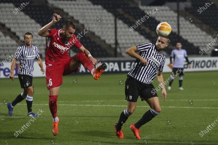 Omonia's Michael Luftner, left, and PAOK's Sverrir Ingi Ingason fight for the ball during the Europa League group E soccer match between PAOK and Omonia at Toumba stadium in the northern city of Thessaloniki, Greece