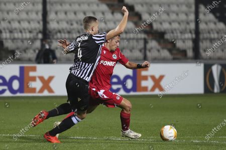 PAOK's Sverrir Ingi Ingason, left, tries to stop Omonia's Eric Bautheac during the Europa League group E soccer match between PAOK and Omonia at Toumba stadium in the northern city of Thessaloniki, Greece