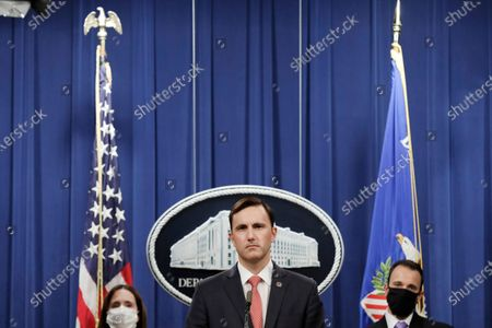 Acting Assistant Attorney General Brian Rabbitt, of the Justice Department's Criminal Division and other officials, speak, at the Justice Department in Washington. A subsidiary of Goldman Sachs pleaded guilty on Thursday and agreed to pay more than $2 billion in a foreign corruption probe tied to the Malaysian 1MDB sovereign wealth fund, which was looted of billions of dollars in a corruption scandal. The company, Goldman Sachs Malaysia, entered the plea in federal court in Brooklyn