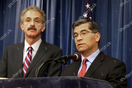 """California Attorney General Xavier Becerra, right, and Los Angeles City Attorney Mike Feuer appear at a news conference in Los Angeles. California-based federal judges have joined in blocking President Donald Trump's executive order excluding people in the U.S. illegally from being counted when congressional districts are redrawn after this year's census. Becerra said a complete and accurate census count """"is critical for ensuring Californians are heard in Congress, and that we get the resources we need to protect the health and well-being of our communities"""