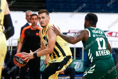 Panathinaikos'  Marcus Foster (R)  in action with Fenerbahce's Edgaras Ulanovas (L) during the Euroleague Basketball match between Panathinaikos OPAP Athens and Fenerbahce Beko Istanbul held at OAKA in Athens, Greece, 22 October 2020.