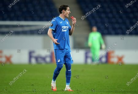 Sebastian Rudy of TSG 1899 Hoffenheim takes out his gumshield during the UEFA Europa League Group L soccer match between TSG Hoffenheim and Crvena Zvezda at PreZero-Arena in Sinsheim, Germany, 22 October 2020.