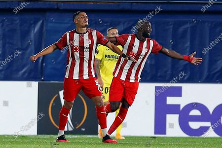 Sivasspor's midfielder Faycal Fajr (L) celebrates during the UEFA Europe League group I soccer match between Villarreal CF and Sivasspor in Vila-real, eastern Spain, 22 October 2020.