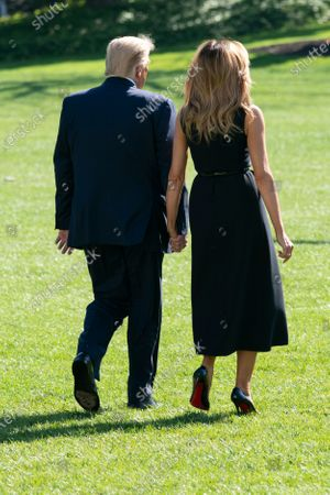 United States President Donald J. Trump and first lady Melania Trump hold hands as they depart the White House in Washington, DC, en route to Nashville, Tennessee where the President will participate in a debate with the Democratic presidential candidate, former US Vice President Joe Biden.