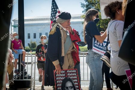 George Washington impersonator James Manship, joins other supporters of Supreme Court Justice nominee Judge Amy Barrett as they gather in front of the Hart Senate Office Building in Washington, DC,. Senate Republicans voted today to advance Barrett's nomination.