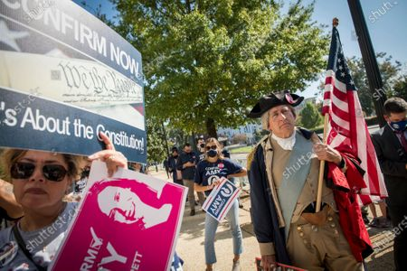 George Washington impersonator James Manship, right, joins other supporters of Supreme Court Justice nominee Judge Amy Barrett as they gather in front of the Hart Senate Office Building in Washington, DC,. Senate Republicans voted today to advance Barrett's nomination.