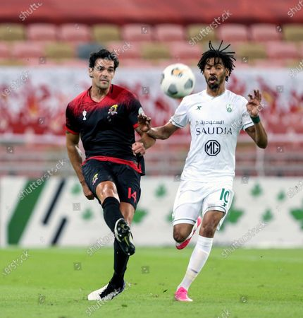 Al-Ahli's player Salman Al-Muwashar (R) in action against Al-Wehda's Alberto Botia (R) during the Saudi Professional League soccer match between Al-Ahli and Al-Wehda at King Abdullah International Stadium, 30 kilometers north of Jeddah, Saudi Arabia, 22 October 2020.