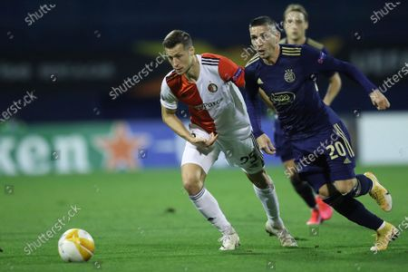 Feyenoord's Uros Spajic, left, is challenged by Dinamo Zagreb's Lirim Kastrati during the group K Europa league soccer match between Dinamo Zagreb and Feyenoord at the Maksimir stadium in Zagreb, Croatia