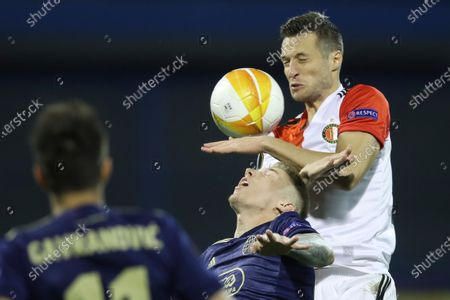 Feyenoord's Uros Spajic, right, jumps for a header with Dinamo Zagreb's Kristijan Jakic during the group K Europa league soccer match between Dinamo Zagreb and Feyenoord at the Maksimir stadium in Zagreb, Croatia