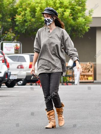 Stock Photo of Scout LaRue Willis is seen on a coffee run wearing boots and a cow print mask