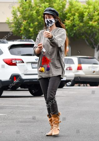 Scout LaRue Willis is seen on a coffee run wearing boots and a cow print mask