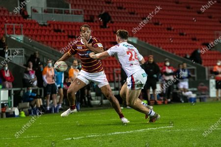 Leroy Cudjoe of Huddersfield  during the Betfred Super League match between Wakefield Trinity Wildcats and St Helens RFC at Totally Wicked Stadium, St Helens