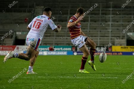 Aiden Sezer puts a kick in  during the Betfred Super League match between Wakefield Trinity Wildcats and St Helens RFC at Totally Wicked Stadium, St Helens