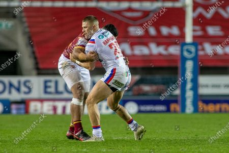 Ryan Hampshire of Wakefield is Tackled during the Betfred Super League match between Wakefield Trinity Wildcats and St Helens RFC at Totally Wicked Stadium, St Helens