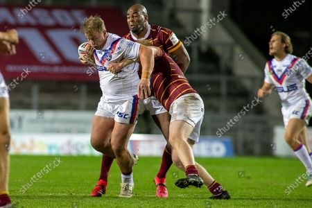 Ed Battye bursts through the Huddersfield Defence during the Betfred Super League match between Wakefield Trinity Wildcats and St Helens RFC at Totally Wicked Stadium, St Helens