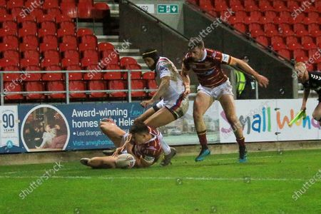 Jacob Wardle Louis Senior and Ben Jones bishop all fight for th eball  during the Betfred Super League match between Wakefield Trinity Wildcats and St Helens RFC at Totally Wicked Stadium, St Helens