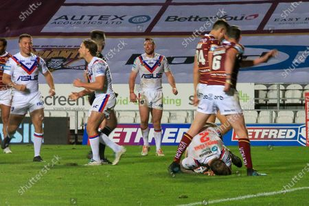 Tom Johnstone scores for wakefield whilst teammates celebrate  during the Betfred Super League match between Wakefield Trinity Wildcats and St Helens RFC at Totally Wicked Stadium, St Helens