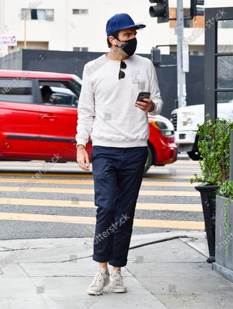 Stock Photo of Zachary Quinto goes for a stroll