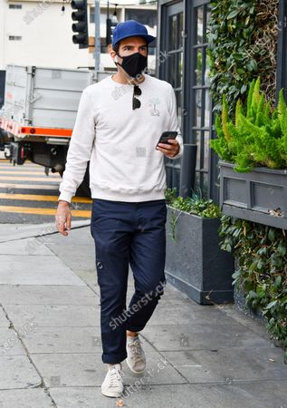 Stock Image of Zachary Quinto goes for a stroll