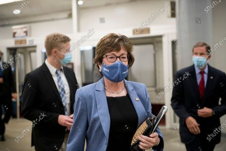United States Senator Susan Collins (Republican of Maine) and other Senators make their way through the Senate subway for a vote at the US Capitol in Washington, DC,.