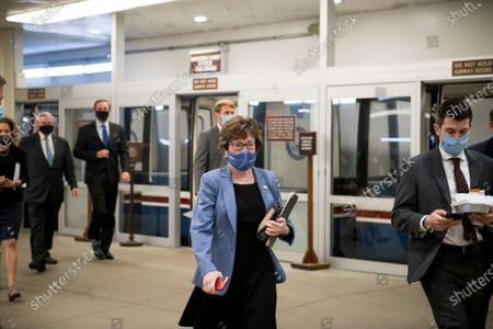 Stock Picture of United States Senator Susan Collins (Republican of Maine) and other Senators make their way through the Senate subway for a vote at the US Capitol in Washington, DC,.