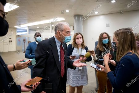 United States Senator Chuck Grassley (Republican of Iowa) and other Senators make their way through the Senate subway for a vote at the US Capitol in Washington, DC,.