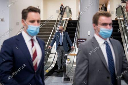 United States Senator Pat Roberts (Republican of Kansas), center, rides down the escalator in the Senate subway following a vote at the US Capitol in Washington, DC,.