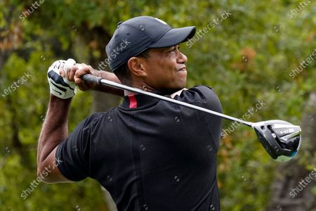 Tiger Woods hits from the 11th tee during the first round of the Zozo Championship golf tournament, in Thousand Oaks, Calif