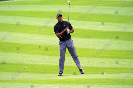 Tiger Woods measures his shot on the 11th fairway during the first round of the Zozo Championship golf tournament, in Thousand Oaks, Calif