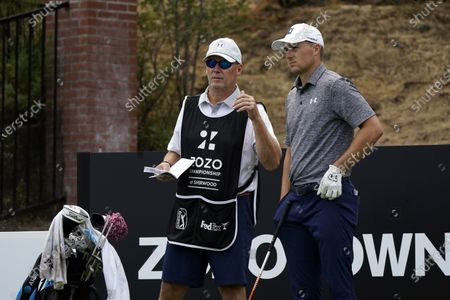 Shawn Spieth, left, caddies for his son Jordan Spieth during the first round of the Zozo Championship golf tournament, in Thousand Oaks, Calif