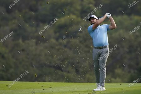 Tyrrell Hatton hits from the 18th fairway during the first round of the Zozo Championship golf tournament, in Thousand Oaks, Calif