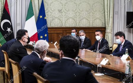 Italian Foreign Minister Luigi Di Maio (2-R) and Fayez al Sarraj (L), head of the Presidential Council of Libya and prime minister of the Government of National Accord of Libya, along with their delegations sit for their  meeting at Chigi Palace, the Italian Foreign Ministry, in Rome, 22 October 2020. Others are not identified.