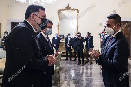 Italian Foreign Minister Luigi Di Maio (R) welcomes Fayez al Sarraj (L), head of the Presidential Council of Libya and prime minister of the Government of National Accord of Libya, for their meeting at Chigi Palace, the Italian Foreign Ministry, in Rome, 22 October 2020. Others are not identified.