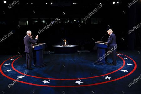 President Donald Trump and Democratic presidential candidate former Vice President Joe Biden participate in the final presidential debate at Belmont University, in Nashville, Tenn., as moderator Kristen Welker of NBC News listens
