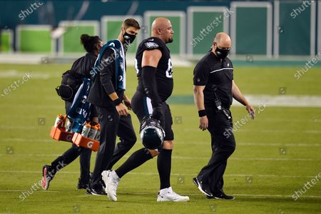 Philadelphia Eagles' Lane Johnson walks off the field after an injury during the first half of an NFL football game against the New York Giants, in Philadelphia