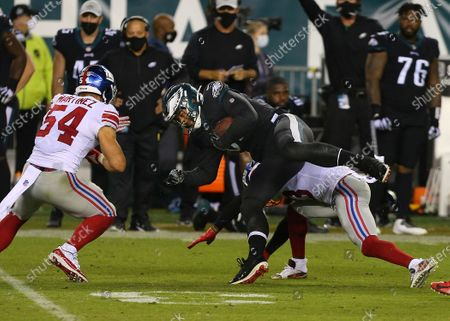 Philadelphia Eagles' Richard Rodgers (85) is tackled by the New York Giants' Sam Beal (23) as Blake Martinez (54) closes in during an NFL football game, in Philadelphia. The Eagles defeated the Giants 22-21