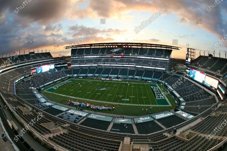 The sun sets behind Lincoln Financial Field before an NFL football game between the New York Giants and Philadelphia Eagles, in Philadelphia