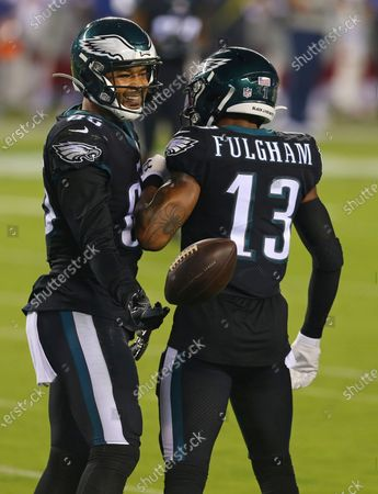 Philadelphia Eagles' Richard Rodgers (85) and Travis Fulgham (13) against the New York Giants' during the first half of an NFL football game, in Philadelphia