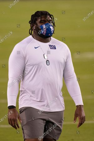 New York Giants nose tackle Dalvin Tomlinson (94) looks on with a Foco mask on prior to the NFL football game against the Philadelphia Eagles, in Philadelphia
