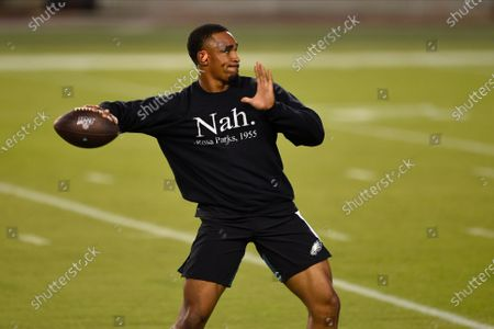 Philadelphia Eagles' Jalen Hurts warms up before an NFL football game against the New York Giants, in Philadelphia