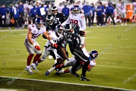 Philadelphia Eagles' Carson Wentz (11) scores a touchdown during the first half of an NFL football game against the New York Giants, in Philadelphia