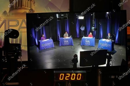 Moderators for the Thursday evening debate between candidates for Washington Lt. Governor are shown on a video monitor as they take part in a sound check and rehearsal, at the TVW studios in Olympia, Wash. Washington Sen. Marko Liias, D-Lynnwood, and U.S. Rep. Denny Heck, D-Wash., will take part in the debate, but they will be in separate rooms in other areas of the building due to concerns over the COVID-19 pandemic. From left, the moderators are Jessica Janner Castro, of KING, Scott A. Leadingham, of Northwest Public Broadcasting, Michelle Esteban, of KOMO, and Mike McClanahan, of TVW