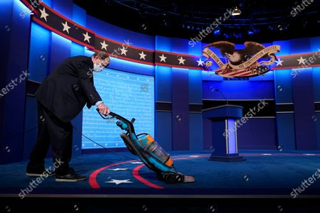 The carpet is vacuumed as final preparations are made ahead of the second and final presidential debate, at Belmont University in Nashville, Tenn