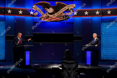 President Donald Trump, left, points towards Democratic presidential candidate former Vice President Joe Biden, right, during the second and final presidential debate, at Belmont University in Nashville, Tenn. Seated in the center is moderator Kristen Welker of NBC News