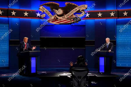 President Donald Trump, left, and Democratic presidential candidate former Vice President Joe Biden, right, during the second and final presidential debate, at Belmont University in Nashville, Tenn. Seated in the center is moderator Kristen Welker of NBC News